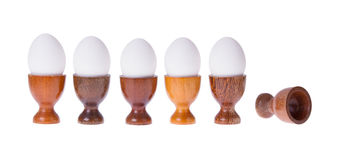 Set of different wooden egg cups stock images