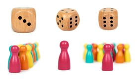 set of different Wooden pawn leisure game figures with dice. Isolated on white background royalty free stock image