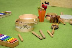 Set of different wooden percussion instruments on green carpet royalty free stock images
