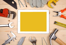 Set of different working tools with tablet Stock Image