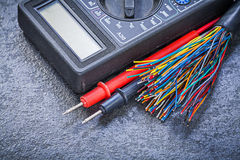 Set of digital multimeter electric tester wires on black backgro Royalty Free Stock Images