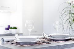 Set of dinner plates in modern kitchen Royalty Free Stock Photos