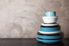 Set of dinnerware on table against grey background with space for text Stock Image
