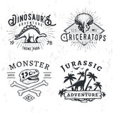 Set of Dino Logos. T-rex skull t-shirt illustration concept on grunge background. stegosaurus adventure park insignia Royalty Free Stock Images
