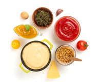 Set of dip sauces in bowl on white stock image