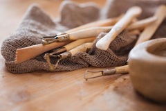 Set of dirty craft sculpting tools in pottery workshop Royalty Free Stock Image