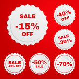 Set of discount paper badges on red background with red text. Vector EPS 10 stock illustration