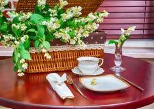 Set of dishes and jasmine flowers Stock Image