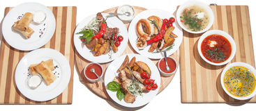 Set of dishes: pancakes with meat, three soup, grilled kebabs, k Stock Image
