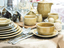 Set of dishes on table Stock Image