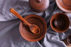 Set of dishes with tablecloth. On wooden table Royalty Free Stock Photography