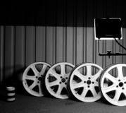 Set of dismantled racing custom car wheels at car workshop at night stock photos Royalty Free Stock Photo