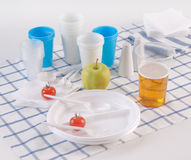Set of disposable dishes. On a kitchen table Stock Photography