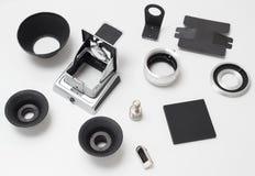 Set dodatkowe części dla antykwarskiej starej średniej format kamery na bielu zdjęcie stock