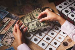 Set of dollars in the pockets through the magnifying glass Stock Photography