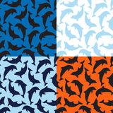 Set Of Dolphins Patterns Stock Images