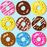 Set of 9 donut icons with different toppings Royalty Free Stock Images