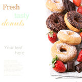 Set of donuts with fresh strawberries Stock Photos