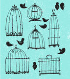 Set of doodle cages and little birds Stock Images