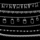 Set of doodle chalk garlands, isolated  borders on blackboard Royalty Free Stock Photography