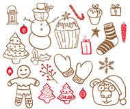 Set of doodle elements. Christmas. A set of twenty-two members comprises a tree, cupcakes, snowman, balls, candle, candy and more. Background white Royalty Free Stock Photo