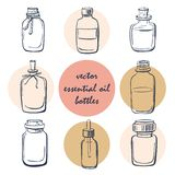 Set of doodle essential oil bottles. Vector set of doodle bottles with essential oil. Collection of simple hand drawn glass vials and flasks. Isolated objects on Stock Photos
