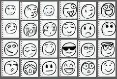 Set of 24 doodle hand drawn smiles on notebook page. VECTOR. Black lines Stock Photo