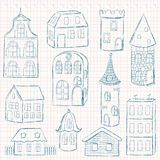 Set of doodle houses on checkered page Stock Image