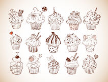 Set of doodle sketch cupcakes with decorations in vintage style. Vector illustration. Stock Images