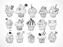 Set of doodle sketch cupcakes with decorations on white background. Vector illustration. Stock Image