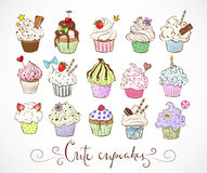 Set of doodle sketch cupcakes with decorations on white background. Vector illustration.  Royalty Free Stock Image