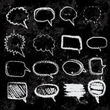Set of doodle sketch speech bubbles on blackboard hand-drawn with color chalks. Royalty Free Stock Photography