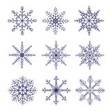 Set of doodle vector snowflakes isolated on white background. Stock Image