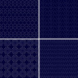 Set of 4 dotted ornamental dark blue seamless patterns Stock Images