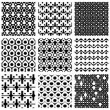 Set of dotted seamless patterns with rings, squares and geometri Stock Photography