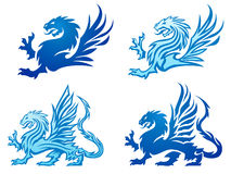 Set of dragon silhouettes. Illustrated set of four different blue dragon silhouettes; isolated on white background Stock Photography