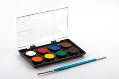Set for drawing. Set of water colour paints and brush for drawing on a white background Royalty Free Stock Photos