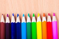 Set of drawing tools on wooden background. Color pencils  on desk Stock Photo