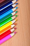 Set of drawing tools on wooden background. Color pencils  on desk Stock Images
