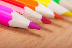 Set of drawing tools on wooden background. Color pencils  on desk Royalty Free Stock Photography