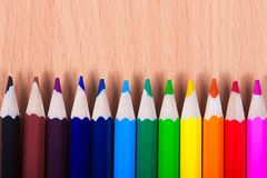 Set of drawing tools on wooden background. Color pencils  on desk Stock Photos
