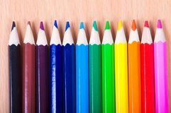 Set of drawing tools on wooden background. Color pencils  on desk Stock Image