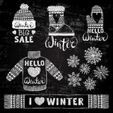 Set drawings knitted woolen clothing and footwear. Sweater, hat, mitten, boot, scarf with patterns, snowflakes. Winter Royalty Free Stock Photography