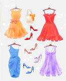 Set of dresses, bag  and high-heeled shoes.  Dresses and shoes. For party. Festive women's attire and accessories.  Fashion cocktail dresses on the hanger Royalty Free Stock Image