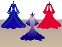 Set dresses on mannequins. Set of three dresses on mannequins Royalty Free Stock Photography