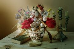 Set of dried flowers in a bouque. T.Still life with dry flowers beautifully collected in a basket royalty free stock photo