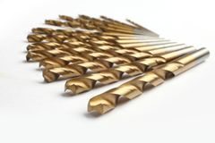 Set of drill. A set of drill bits of golden color Stock Photography