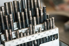 Set of drill bits in a workshop Royalty Free Stock Image