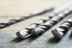 Set of drills on wooden table. Closeup Stock Images