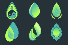 Set of drop and leaf vector icons on dark background. Royalty Free Stock Image